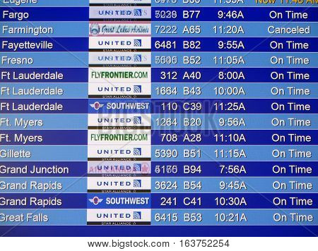 Denver, Usa - February 25: Close Up View Of Flights Schedule In Denver Airport On February 25, 2014