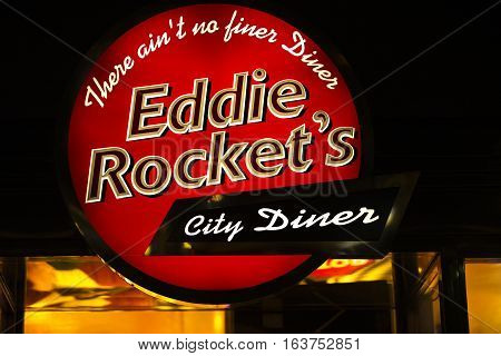Dublin, Ireland - 30 Dec 2016: Eddie Rocket's Irish restaurant chain logo, diner in Omni shopping centre, Dublin. American-style food in 1950s' style diners