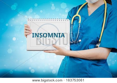 Doctor Shows Insomnia Text On White Line Paper Book.