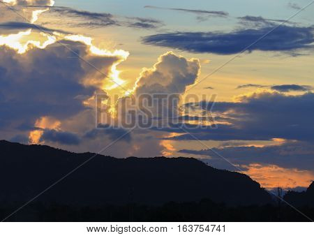 sky in sunset and raincloud colorful twilight time with mountain silhouette art beautiful in nature