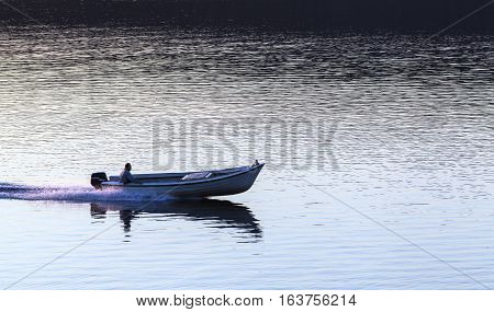 BALTIC SEA, SWEDEN ON JULY 25. View of a motorboat, speedboat passes the photographers position on July 25, 2013 at the Baltic Sea, Sweden. Sunset, calm sea and speed. Editorial use.