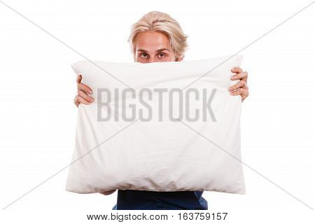Man hiding her face behind pillow copy space for text isolated on white