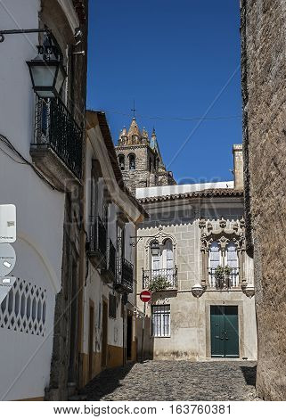 Portugal ,Evora . Stone houses and streets, paved with stone, in the old city. Bright spring day , blue sky.