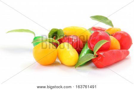 Front group of deletable imitation fruits on white floor.