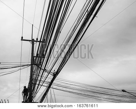 Power line support, insulators and wires. Appearance of a design. Assembly and installation of new support and wires of a power line