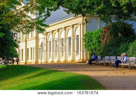 London UK - October 17 2016 - Tourists siting on benches in front of Kenwood House