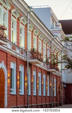 Detail of the facade historic building of the 19th century in late evening. Russian architecture. Now Belgorod Region Department of Culture. Belgorod city, Russia.