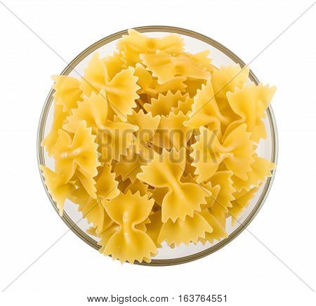 Pasta In Form Of Ribbons In Transparent Bowl On White