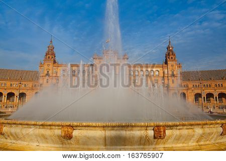 Fountain on Plaza de Espana - Spanish Square in Seville Andalusia Spain. The Plaza de España is a plaza in the Parque de María Luisa in Seville Spain built in 1928 for the Ibero-American Exposition of 1929.