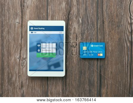 Digital touch screen tablet and credit card: mobile payments and banking app concept