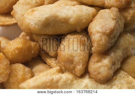 Takeout box of sweet and sour chicken and corn nuggets