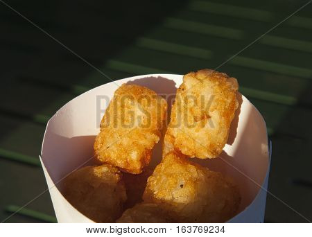 Deep fried potato shavings in a takeout container