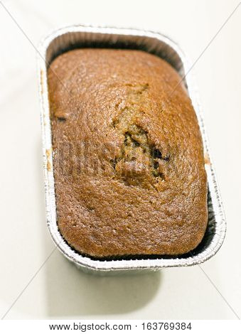 An uncut pound cake in the pan