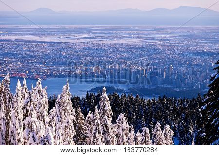 Winter sunset over city of Vancouver. View from Hollyburn Mountain. Cypress Provincial Park. North Vancouver. British Columbia. Canada.