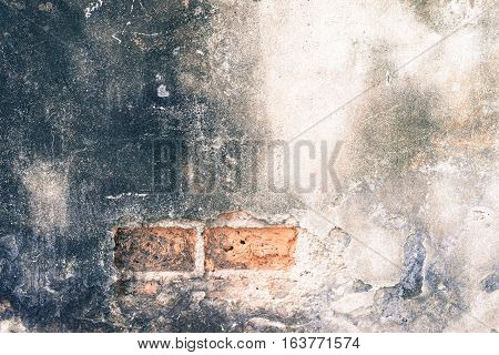 Old wall disintegrated over time in dark shine.