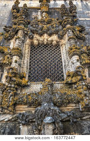 Portugal. The famous window Janela do Capítulo at the Convento de Cristo in Tomar.Manueline . Magnificent stone carving .