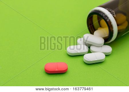One red medicine tablet is as a concept of a vaccine.