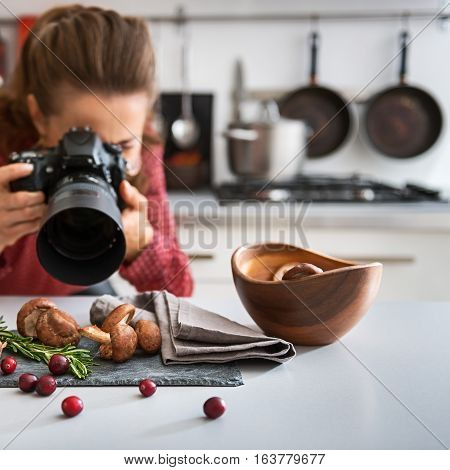 Woman Food Photographer Taking Closeup Of Mushrooms