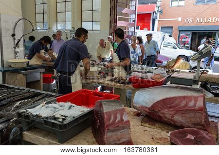 FUNCHAL PORTUGAL - SEPTEMBER 2 2016: Fish sellers at Mercado dos Lavradores the famous fish and seafood market of Funchal Madeira island