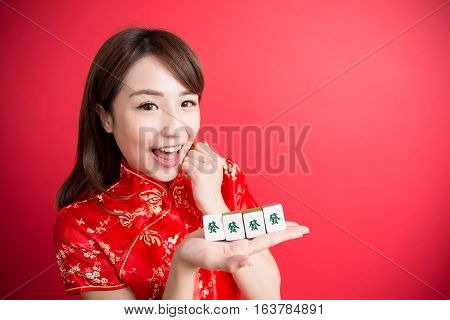 beauty woman wear cheongsam and show mahjong to you in chinese new year