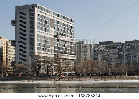 Bucharest Romania : Landscape with tall residential blocks and lake in a Bucharest suburb.