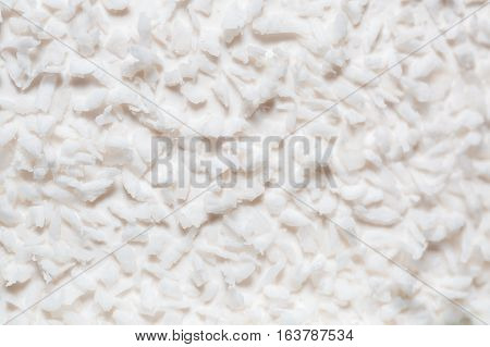 white coconut shavings on the cake. background and texture