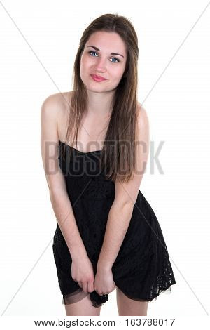 Young And Pretty Girl With Blue Eyes With A Black Dress In The Photo Studio