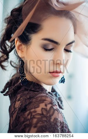 Retro portrait of a beautiful woman with closed eyes. Vintage style. Professional make-up and hairstyle. Fashion photo