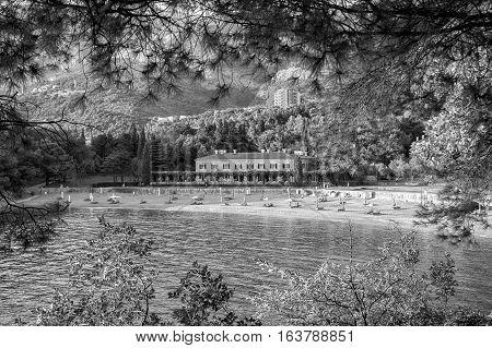 Sveti Stefan Montenegro - August 24 2015: Milocher hotel in Montenegro near Sveti Stefan. King and Quine beach. Vintage black and white