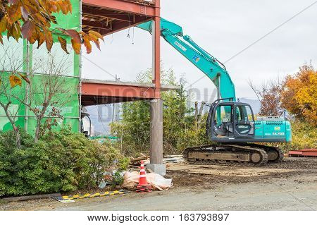TOKYO, JAPAN - 20 NOV 2016: A big excavator earthmoving works on new construction site in Kawaguchiko Lake Japan