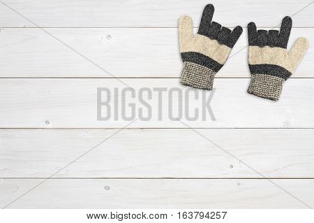 winter brown knitting wool glove one pair for hand protection and i love you symbol on top view white vintage wood table or floor background for valentine day on winter with copyspace
