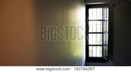 Light coming through a window and reflecting into the wall of a room.