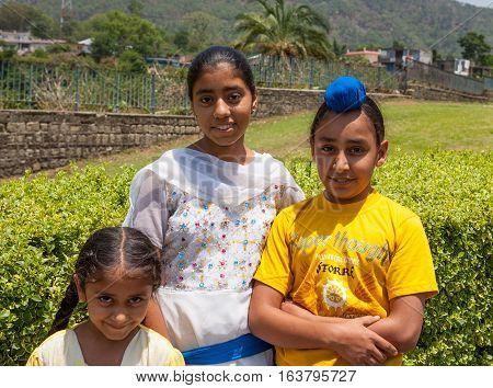 MANDI, INDIA. 4 June 2009: Rural residents in daily life.  Portrait of a young Sikh pilgrims children near Gurudwara. Himachal Pradesh, India.