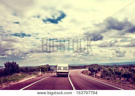 Landscape and caravan.Caravan travel road concept and lifestyle. Caravan lifestyle road and landscape in vintage old style.