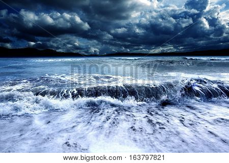 Stormy seascape .Ocean storm.Waves and dark cloudy sky