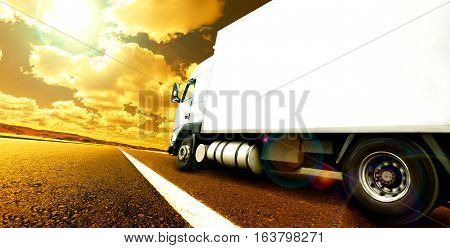 Truck and transport. Lorry delivering freight by road or highway. International delivering goods trailer