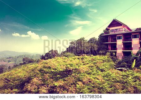 House and landscape.Exotic places and tourism.Travel and hotel concept.Vintage style.Exotic travels and adventures .Thailand trip.Chiang Mai landmarks