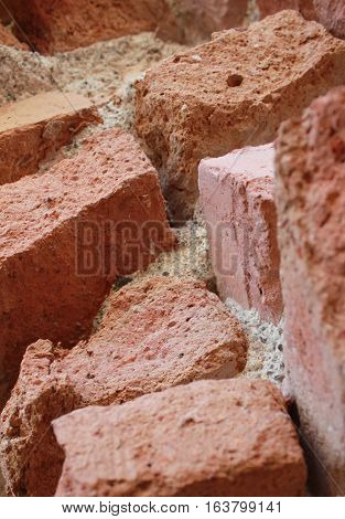 Close up of red bricks found in an old derelict factory.