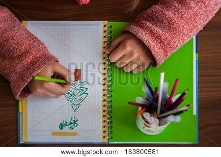 Beautiful Cute Little Blond Girl With Glasses And Purple Dress Working Or Drawing Or Coloring In The