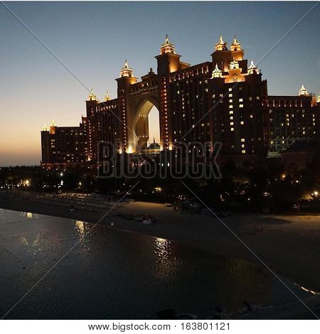 Romantic sunset view from the ocean of the majestic Atlantis Palm