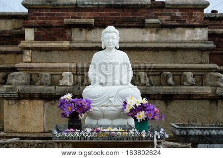 Marble Buddha's statue at entering Mirisavatiya Dagoba in the complex of Anuradhapura ruins ruin historical capital city of the Sinhalese Buddhist state on Sri Lance.
