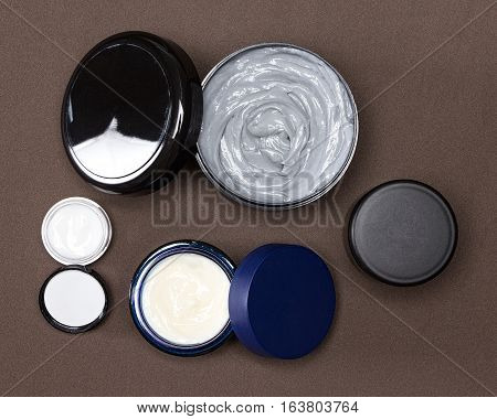 Several jars with creams. Various skin care cosmetic products. Skincare for men