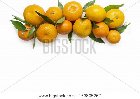 Mandarins. Tangerines close-up on a white background. Background tangerines. Top view with copy space. Top view.