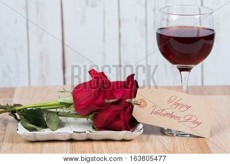 Happy Valentine's Day message with wine and roses