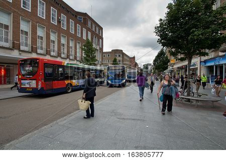 EXETER DEVON UK 11.07.2016: Buses and pedestrains on the High Street