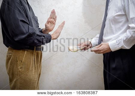 Man Offering  A Hryvnia Bribe To A Man Refusing It