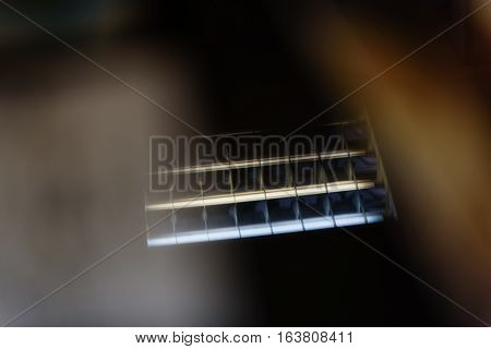 Abstract background, shallow depth of focus. Blurred reflection of fluorescent lamps