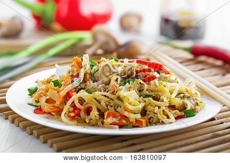 Traditional Asian meal made of rice noodles vegetables tofu and shiitake mushroom. Oriental cuisine food.