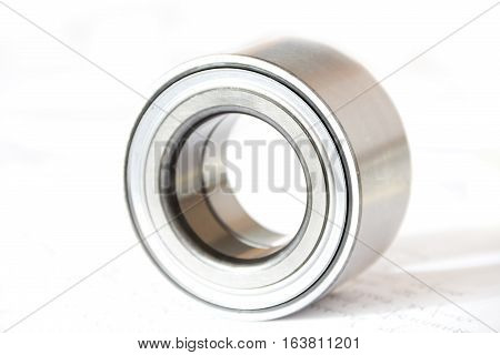Metal parts for the car bearing on white background