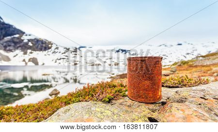 Old Rusty Can On Lake Shore. Earth Ecology
